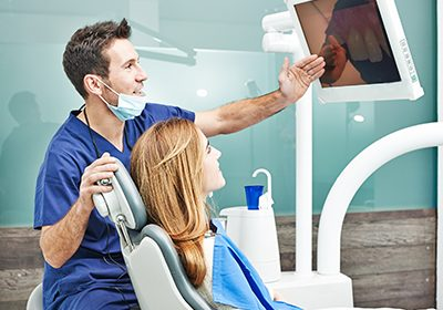 dentist-consulting-with-patient