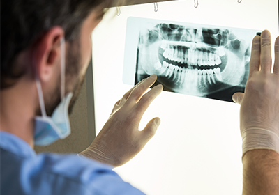 dentist-examining-dental-x-ray