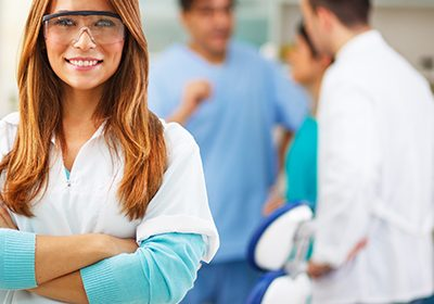 female-dentist-smiling-with-arms-crossed-at-a-dental-office